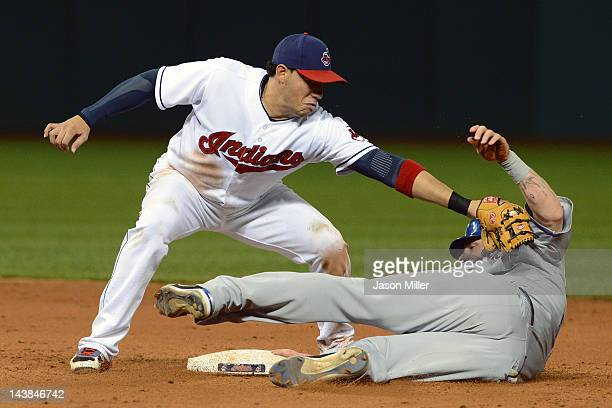 Shortstop Asdrubal Cabrera of the Cleveland Indians tags out Josh Hamilton of the Texas Rangers on an attempted steal during the eighth inning at...