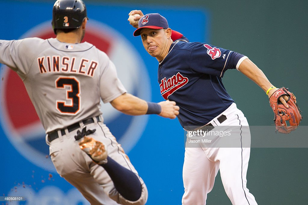 Shortstop Asdrubal Cabrera #13 of the Cleveland Indians turns a double play as Ian Kinsler #3 of the Detroit Tigers is out at second base to end the top of the third inning at Progressive Field on May 20, 2014 in Cleveland, Ohio.