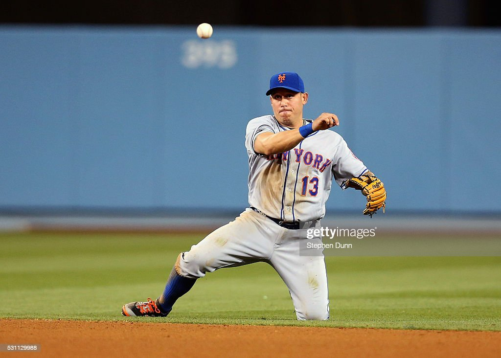 Shortstop Asdrubal Cabrera #13 of the New York Mets throws to first from his knee after diving to catch a ground ball to get Joc Pederson #31 of the Los Angeles Dodgers for the second out of the sixth inning at Dodger Stadium on May 12, 2016 in Los Angeles, California. The Dodgers won 5-0.
