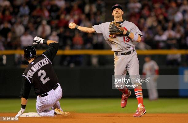 Shortstop Brendan Ryan of the St Louis Cardinals turns a double play on Troy Tulowitzki of the Colorado Rockies on a ball hit by Brad Hawpe to Cards...