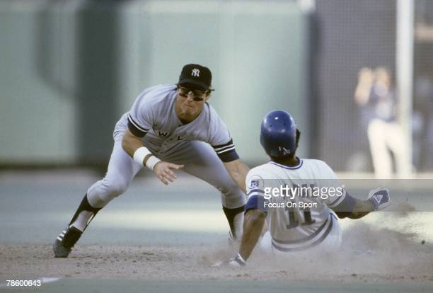 Shortstop Bucky Dent of the New York Yankees tags out Hal McRae of the Kansas City Royals attempting to steal second base during a MLB baseball game...