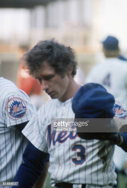 Shortstop Bud Harrelson of the New York Mets is led to the dugout after his fight with Pete Rose of the Cincinnati Reds during Game Three of the...
