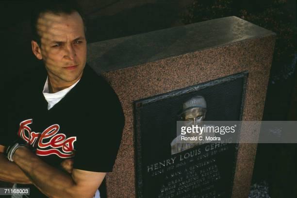 Shortstop Cal Ripken, Jr. #8 of the Baltimore Orioles leans against the Lou Gehrig memorial monument in Yankee Stadium before a June 1990 game.