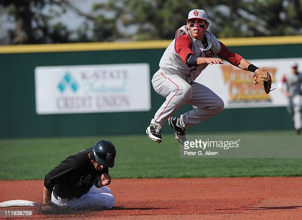 Shortstop Caleb Bushyhead of the Oklahoma Sooners completes a double play in the sixth inning with a throw to first over base runner Mike Kindel of...