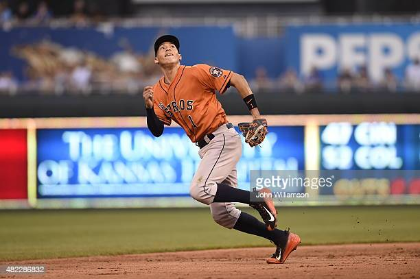 Shortstop Carlos Correa of the Houston Astros runs to catch a fly ball in the game against the Kansas City Royals on July 25 2015 at Kauffman Stadium...