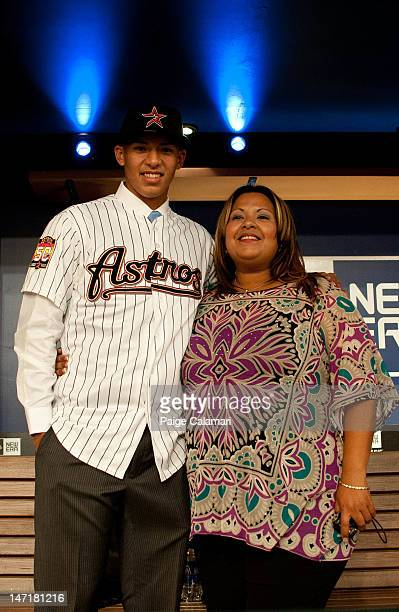 Shortstop Carlos Correa who was drafted out of the Puerto Rico Baseball Academy by the Houston Astros with the top overall selection poses with his...