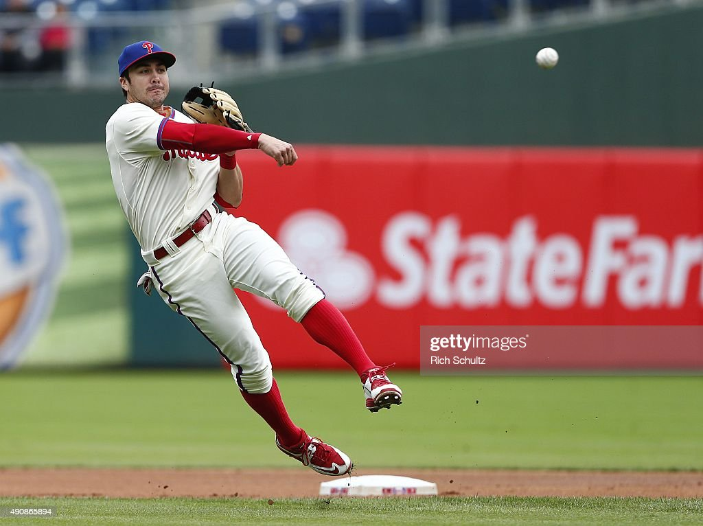 Shortstop Chase d'Arnaud #2 of the Philadelphia Phillies makes a throw to first base to get Kelly Johnson #55 the New York Mets during the first inning of a MLB game at Citizens Bank Park on October 1, 2015 in Philadelphia, Pennsylvania. The Phillies defeated the Mets 3-0.
