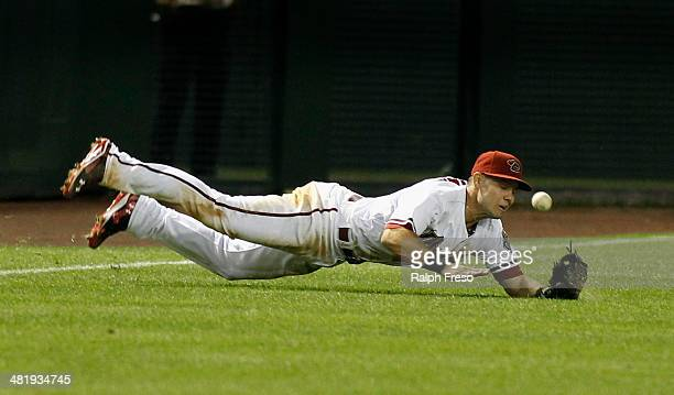 Shortstop Chris Owings of the Arizona Diamondbacks has the ball bounce away after trying to make a diving catch of a shallow fly ball against the San...