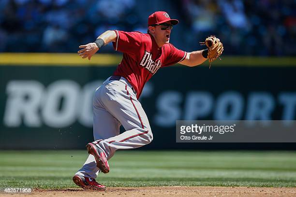Shortstop Cliff Pennington of the Arizona Diamondbacks fields a grounder against the Seattle Mariners at Safeco Field on July 29 2015 in Seattle...