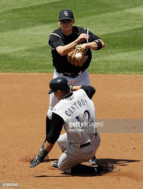 Shortstop Clint Barmes of the Colorado Rockies completes a double play against Alex Cintron of the Arizona Diamondbacks in the second inning on May...