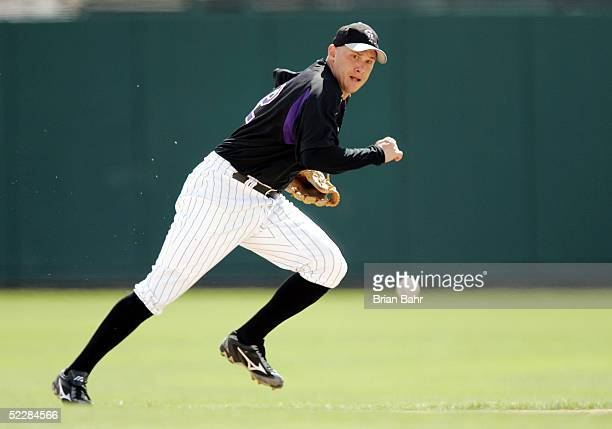 Shortstop Clint Barmes of the Colorado Rockies misses a bouncing ground ball hit by Gary Matthews Jr of the Texas Rangers in the third inning of a...
