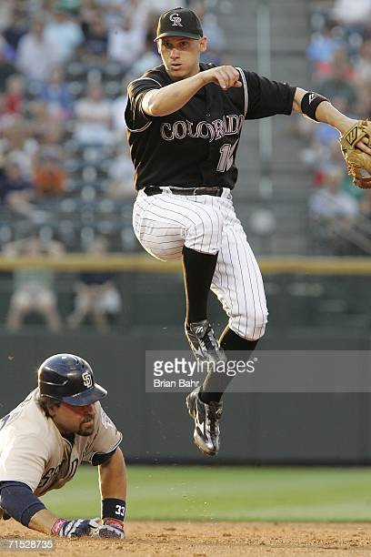 Shortstop Clint Barmes of the Colorado Rockies throws to first for a double play after getting the out against Mike Piazza of the San Diego Padres at...