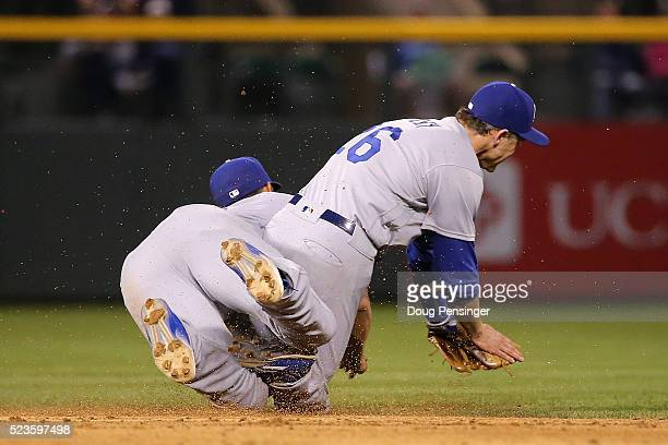 Shortstop Corey Seager of the Los Angeles Dodgers makes the stop on a ground ball by Carlos Gonzalez of the Colorado Rockies and collides with second...