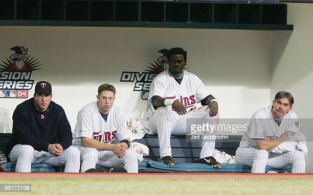 Shortstop Cristian Guzman of the Minnesota Twins watches game three of the American League Divisional Series against the New York Yankees at the...