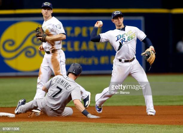 Shortstop Daniel Robertson of the Tampa Bay Rays gets the forced out on Andrew Romine of the Seattle Mariners at second base then turns the double...