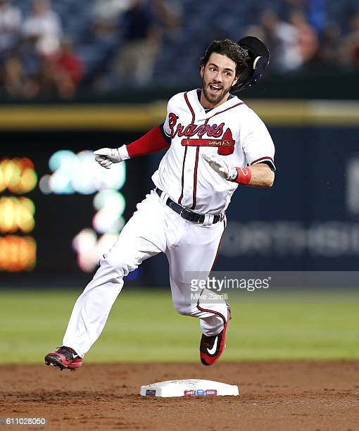 Shortstop Dansby Swanson of the Atlanta Braves runs past second base on his way to third base for an RBI triple in the second inning during the game...