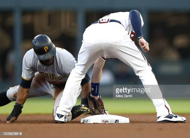 Shortstop Dansby Swanson of the Atlanta Braves tags out centerfielder Starling Marte of the Pittsburgh Pirates on a stolen base attempt in the first...
