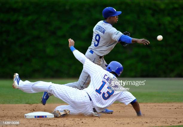 Shortstop Dee Gordon of the Los Angeles Dodgers throws to first base to complete a double play on a ground ball hit by Bryan LaHair of the Chicago...