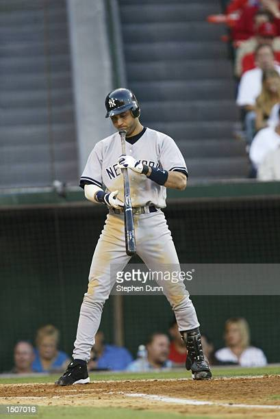Shortstop Derek Jeter of the New York Yankees at bat during game 3 of the American League Divisional Series against the Anaheim Angels on October 4...