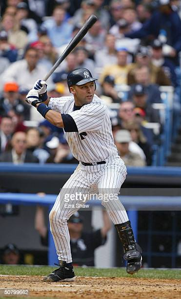 Shortstop Derek Jeter of the New York Yankees at bat during the game against the Chicago White Sox on April 8 2004 at Yankee Stadium in the Bronx New...