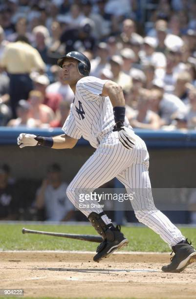 Shortstop Derek Jeter of the New York Yankees eyes his batted ball leave the yard for his 11th home run of the season in the first inning against Al...