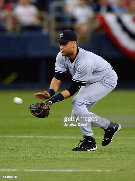 Shortstop Derek Jeter of the New York Yankees fields a ball against the Minnesota Twins during game four of the American League Divisional Series at...