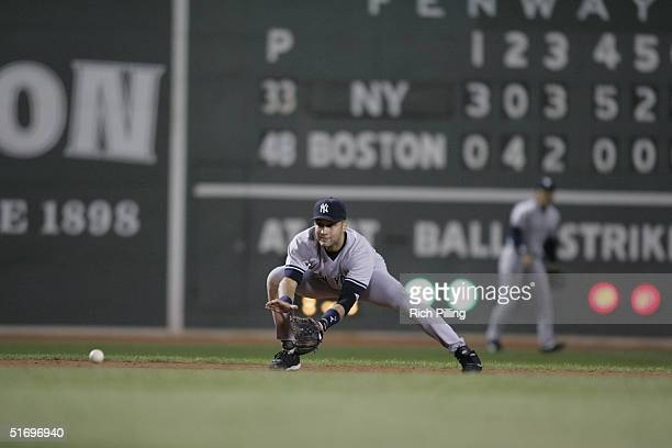 Shortstop Derek Jeter of the New York Yankees fields during game three of the ALCS against the Boston Red Sox at Fenway Park on October 16 2004 in...