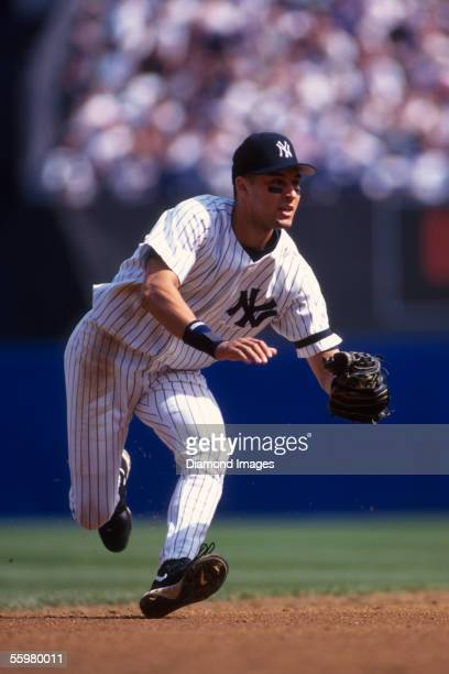Shortstop Derek Jeter of the New York Yankees gets into position to field a groundball during a game in 1996 at Yankee Stadium in New York New York