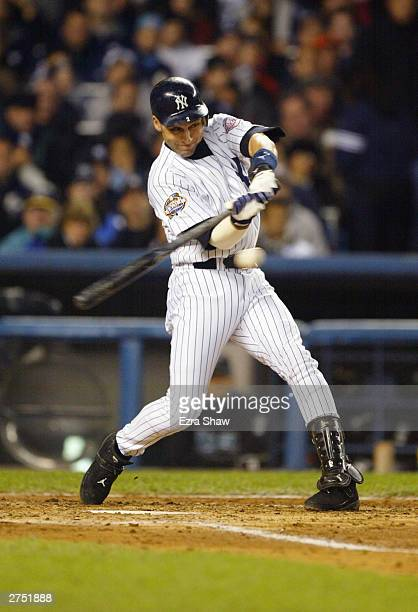 Shortstop Derek Jeter of the New York Yankees is at bat during game six of the Major League Baseball World Series against the Florida Marlins on...