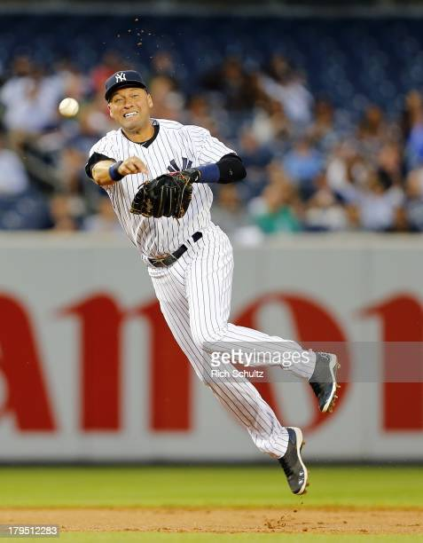 Shortstop Derek Jeter of the New York Yankees makes a throw to first base to get Jeff Keppinger of the Chicago White Sox to end the first inning in a...