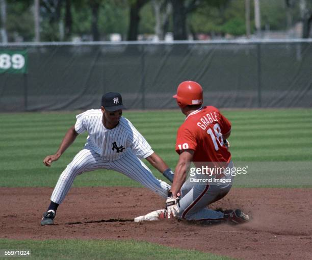 Shortstop Derek Jeter of the New York Yankees puts the tag on Rob Grable of the Philadelphia Phillies during a Spring Training game on March 23 1995...