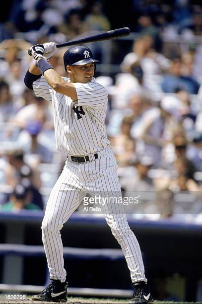Shortstop Derek Jeter of the New York Yankees readies for the pitch during an MLB game against the Anaheim Angels at Yankee Stadium on May 19 1996 in...