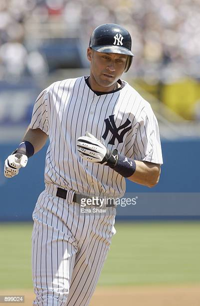 Shortstop Derek Jeter of the New York Yankees rounds the bases after hitting his 11th home run of the season in the first inning against Al Leiter of...