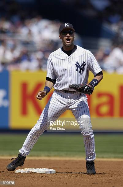 Shortstop Derek Jeter of the New York Yankees stands at second base during the MLB game against the Seattle Mariners at Yankee Stadium in the Bronx...