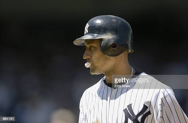 Shortstop Derek Jeter of the New York Yankees stands on the field during the MLB game against the Boston Red Sox at Yankee Stadium in the Bronx New...