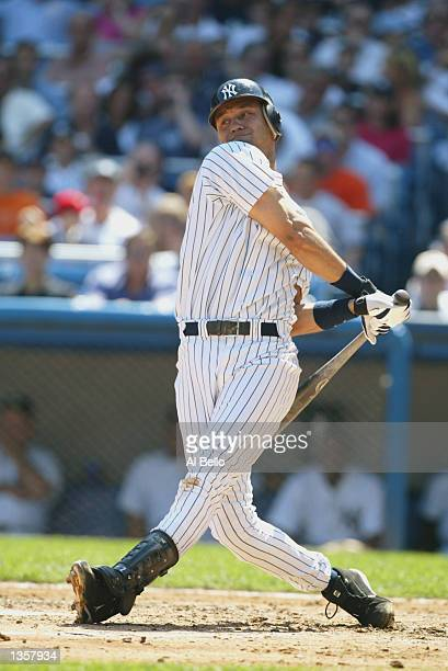 Shortstop Derek Jeter of the New York Yankees swings the bat against the Anaheim Angels during the game at Yankee Stadium on August 21 2002 in the...
