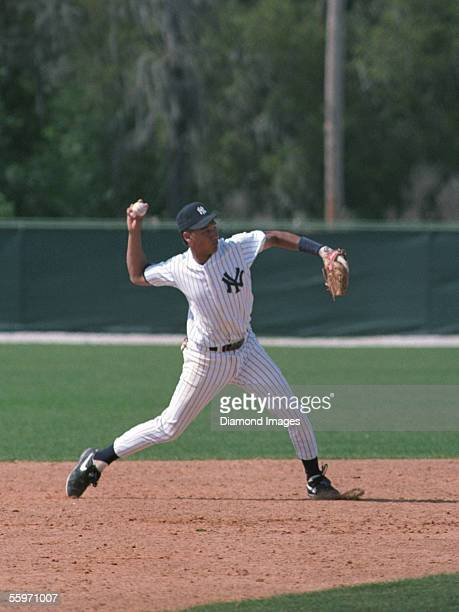 Shortstop Derek Jeter of the New York Yankees throws the ball to firstbase during Spring Training in March 1993 at the Yankees' minor league complex...