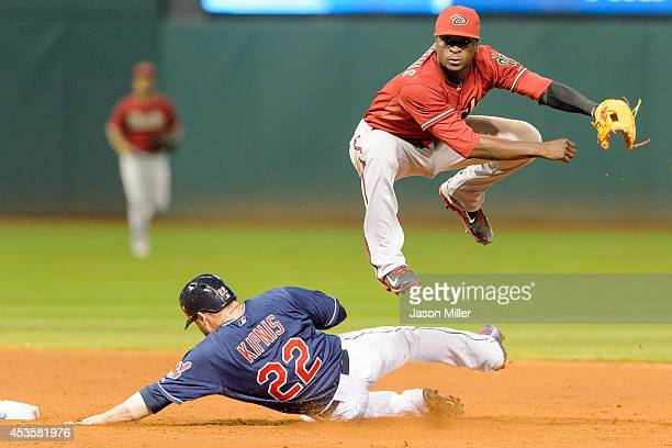 Shortstop Didi Gregorius of the Arizona Diamondbacks throws out Mike Aviles at first as Jason Kipnis of the Cleveland Indians is out at second to end...