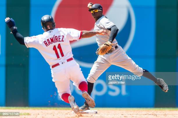 Shortstop Didi Gregorius of the New York Yankees throws out Yonder Alonso of the Cleveland Indians at first as Jose Ramirez is out at second for a...