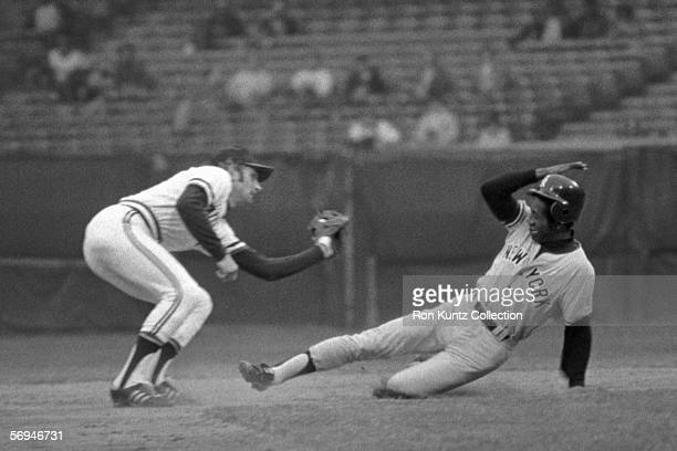 Shortstop Duane Kuiper, of the Cleveland Indians, receives the throw from the catcher and prepares to tag Paul Blair, of the New York Yankees, trying...