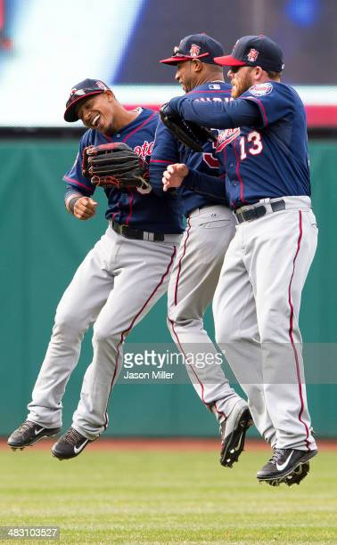 Shortstop Eduardo Escobar center fielder Aaron Hicks and Jason Kubel of the Minnesota Twins celebrate after the Twins defeated the against the...