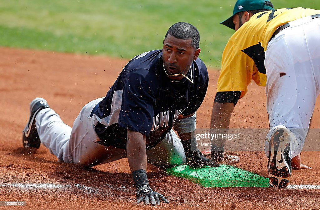Shortstop Eduardo Nunez #26 of the New York Yankees steals third base against the Pittsburgh Pirates during a Grapefruit League Spring Training Game at McKechnie Field on March 17, 2013 in Bradenton, Florida.