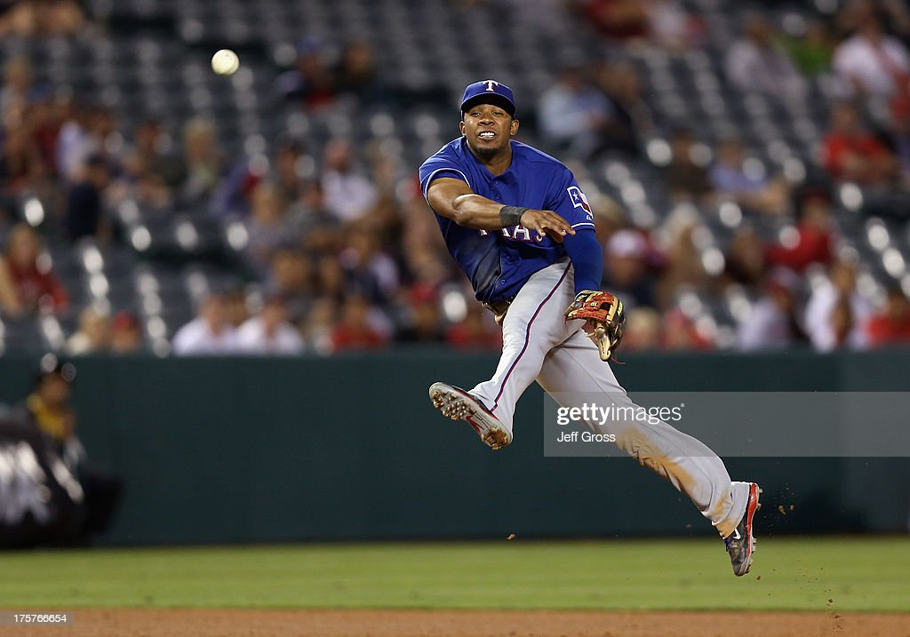 Shortstop Elvis Andrus #1 of the Texas Rangers is unable to throw Grant Green (not pictured) of the Los Angeles Angels of Anaheim out at first in the ninth inning at Angel Stadium of Anaheim on August 7, 2013 in Anaheim, California. The Rangers defeated the Angels 10-3.