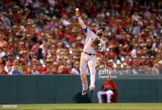 Shortstop Elvis Andrus of the Texas Rangers leaps in the air as he throws to first to get Collin Cowgill of the Los Angeles Angels of Anaheim to end...
