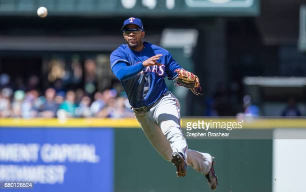 Shortstop Elvis Andrus of the Texas Rangers throw to first for the out on a ball hit by Guillermo Heredia of the Seattle Mariners during the fifth...
