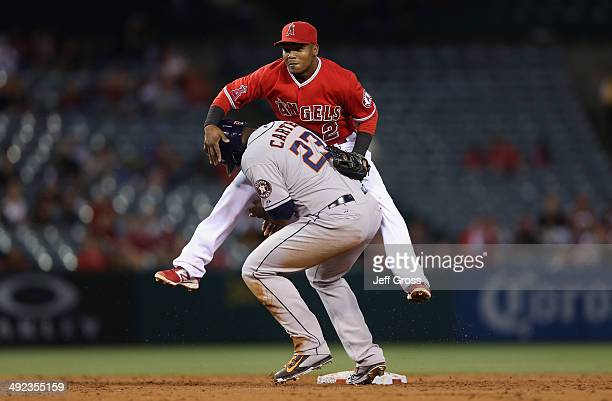 Shortstop Erick Aybar of the Los Angeles Angels of Anaheim grabs Chris Carter of the Houston Astros after forcing him out at second base as part of a...