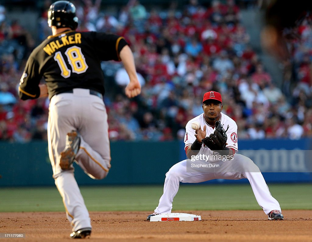 Shortstop Erick Aybar #2 of the Los Angeles Angels of Anaheim takes the throw to force out Neil Walker #18 of the Pittsburgh Pirates on a fielder's choice in the second inning at Angel Stadium of Anaheim on June 22, 2013 in Anaheim, California.