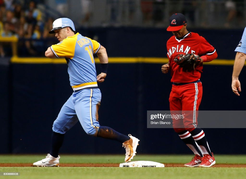 Shortstop Francisco Lindor #12 of the Cleveland Indians hauls in the throw from first baseman Carlos Santana to complete the double play with the out at second base on Corey Dickerson #10 of the Tampa Bay Rays during the first inning of a game on August 12, 2017 at Tropicana Field in St. Petersburg, Florida.