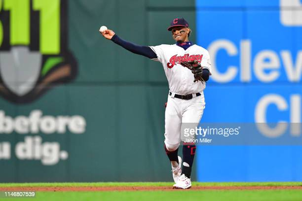 Shortstop Francisco Lindor of the Cleveland Indians throws out Edwin Encarnacion of the Seattle Mariners at first during the sixth inning at...