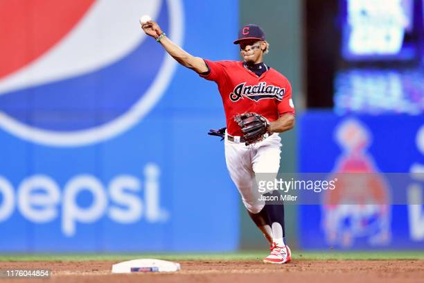 Shortstop Francisco Lindor of the Cleveland Indians throws out Maikel Franco of the Philadelphia Phillies at first during the third inning at...
